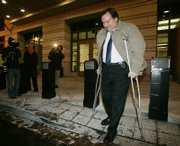 Tim Russert, Washington bureau chief of NBC News, walks with the aid of crutches as he leaves U.S. Federal Court in Washington. Russert testified as the key prosecution witness Wednesday in the Scooter Libby CIA leak trial.