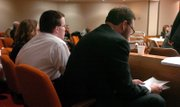 Jason Rose and his attorney Ron Evans listen to the video of Rose's interview with Lawrence detectives.