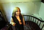 Chana Taub stands on the entrance staircase where a court-ordered wall now separates her from her ex-husband.
