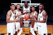 Michigan's fab five, from left, Jimmy King, Juwan Howard, Chris Webber, Jalen Rose and Ray Jackson pose for this Nov. 1991 file photo.
