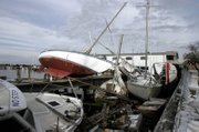 Boats remained piled up following Hurricane Katrina at the Municipal Yacht Harbor in New Orleans. A compromised quality of life and uncertainty about New Orleans' future after Hurricane Katrina have the city on edge, threatening to push younger, more educated residents away and exclude poor people from the recovery. It is almost 18 months since Hurricane Katrina flooded the city.