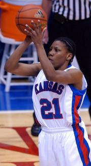 KANSAS UNIVERSITY SENIOR POINT GUARD SHAQUINA MOSLEY shoots a three-pointer against Iowa State in Allen Fieldhouse. Mosley made the game-winning shot in each of the Jayhawks' two Big 12 Conference victories this season - both coming last week after an 0-9 start.