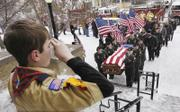 Nick Zorn 10, a Webelos scout in Glendive, Mont., salutes as the honor guard brings Army Pvt. Matthew Zeimer's casket into Sacred Heart Catholic Church in Glendive. Zeimer was killed Feb. 2 in a firefight in Ramadi, in central Iraq. He is one of the 3,126 members of the U.S. military who have died since the beginning of the Iraq war in March 2003.