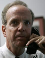 U.S. Rep. Jerry Moran, R- Kan., talks on the phone with constituents in his Capital Hill office Monday, Jan. 29, 2007 in Washington. Moran is taking advantage of a new technology that allows him to talk to thousands of people on a single phone call.