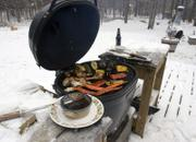 Larger grills are prized for their ability to retain heat, making them popular choices with year-round grill enthusiasts. The right equipment and clothing will help give you that charcoal taste all year round.