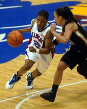 Kansas University's Shaquina Mosley, left, tries to drive on Missouri's Blair Hardiek. Despite a career-high 22 from Mosley, the Jayhawks fell to the Tigers, 67-57, Wednesday at Allen Fieldhouse.