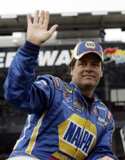 Michael Waltrip waves to fans as drivers are introduced before the first of two Gatorade Duel qualifying races. Waltrip placed eighth in his race Thursday in Daytona Beach, Fla.