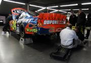 NASCAR officials inspect the car of driver Jeff Gordon in the Grand National Garage. The vehicle failed postrace inspection Thursday in Daytona Beach, Fla., and he will start the Daytona 500 in 42nd position.