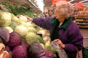 Lawrence resident Altha Lusk picks out some produce at Checker's, one of the closest grocery stores to downtown Lawrence.