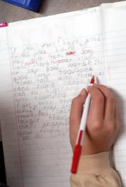 A student corrects a writing assignment.