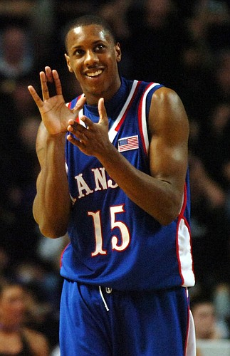 Kansas guard Mario Chalmers claps as the Jayhawks begin to widen their lead in the second half of Monday night's game against the Wildcats at Bramlage Coliseum.