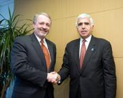 Gary Parsons, Chairman of XM Satellite Radio, left, and Mel Karmazin, CEO of Sirius Satellite Radio, shake hands Monday in Washington, D.C., following the signing of the merger agreement between the two companies. The deal still must be approved by federal regulators.