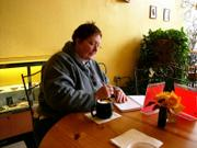 Kathy Jardon writing in her journal and visiting with friend who came in the Baldwin  coffee shop, &quot;Express Yourself.&quot; November, 2005.