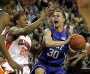 Duke's Jon Scheyer (30) runs into Clemson's Cliff Hammonds (25) as he drives to the basket. Duke's victory against Clemson on Thursday extended its winning streak to three games.