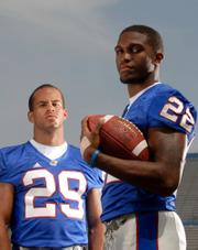 Angus Quigley, right, was slated to back up KU starting running back Jon Cornish, left, in 2006 before a bizarre thigh injury landed him in a wheelchair.