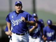 Kansas City Royals captain Mike Sweeney leads the team through drills. Sweeney, who has turned to yoga to help him overcome a chronically bad back, put the Royals through their paces Thursday in Surprise, Ariz.