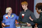 Eleanor Symons, left, and Justin Esau are honored by United Way of Douglas County and the Roger Hill Volunteer Center on Thursday at the Lawrence Arts Center. Symons, a retired Kansas University libraries employee, was the adult winner of the Wallace Galluzzi Outstanding Volunteer Award, and Esau, a Bishop Seabury Academy senior, won the youth award.