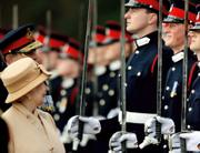 Britain's Prince Harry, second from right, grins at his grandmother, Queen Elizabeth II, while she inspects the Sovereign's Parade in April at the Royal Military Academy in Sandhurst, England. The Ministry of Defense ended speculation that had been swirling for about a week by announcing Thursday that the 22-year-old prince will be sent to Iraq with his Blues and Royals regiment in May or June. Harry, a second lieutenant, will assume a troop commander's role.
