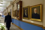 Portraits of former Kansas University chancellors, including KU's first chancellor, Rev. R.W. Oliver, at far right, who served from 1865 to 1867, line the a wall near the chancellor's office. The administrative offices on the second floor of Strong Hall have recently undergone renovations totaling almost $107,000, including a new paint job, a $30,000 overhaul of the kitchen and $8,000 for radiator covers.