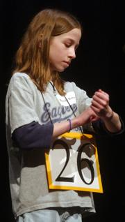 Miranda Rohn traces a word on her arm before spelling out loud at the bee.