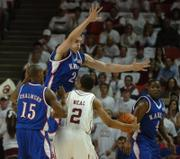 Kansas center Sasha Kaun looks to smother a pass from Oklahoma guard Michael Neal as he and guards Mario Chalmers and Sherron Collins defend against the Sooners during the first half of Monday night's game at Lloyd Noble center in Norman.