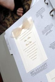 Lawrence wedding consultant Carmen Hocking says dark brown and pale blue are popular color combinations right now, and so dark brown ink is becoming a trendy color for invitation type.