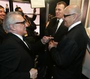 "Director Martin Scorsese, left, holding his Oscar for best director for his work on ""The Departed"" chats with Jack Nicholson and ""The Departed"" producer Graham King, center, at the 79th Academy Awards Sunday in Los Angeles. ""The Departed"" won best motion picture of the year. Scorsese won his first Best Director Oscar after being nominated multiple times."
