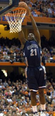 Georgetown's Jesse Sapp dunks after a steal against Syracuse. The Hoyas fell to the Orange in Syracuse, N.Y., after moving up to No. 9 in the AP poll earlier Monday.
