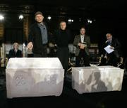 Simcha Jacobovici, standing at left, an investigative journalist, director, producer and writer, points to an ossuary - a small casket to store bones - he and others say once may have held the remains of Mary Magdalene. The ossuary at right may have held the remains of Jesus of Nazareth, Jacobovici said during a news conference Monday in New York. James Cameron, middle, produced a new documentary that says 10 ancient ossuaries discovered in 1980 in a suburb of Jerusalem may have contained the bones of Jesus and his family. Also pictured are Charles Pellegrino, second from right, and Andrey Feuerverger, far right.
