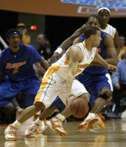 Tennessee's Chris Lofton drives against Florida's Chris Richard. Tennessee won, 86-76, on Tuesday night in Knoxville, Tenn.