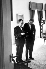 This photo provided by the John F. Kennedy Presidential Library shows Arthur M. Schlesinger Jr., left, and President Kennedy on July 26, 1962, in the White House Oval Office. Schlesinger died Wednesday after suffering a heart attack while dining with family members in New York. He was 89.