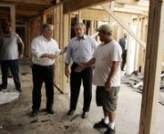 Mississippi Gov. Haley Barbour, left, and President Bush visit a home being rebuilt in Long Beach, Miss., after Hurricane Katrina. The president said he wanted to let people know they have not been forgotten and to show American taxpayers how their money is being used for recovery.