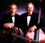 "Comedian Tommy Smothers, left, and Dick Smothers have been performing as the Smothers Brothers for nearly 50 years. ""Thank God I was born with a funny brother,"" says Dick Smothers, who will appear  Sunday in Topeka."