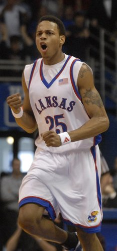 Kansas guard Brandon Rush pumps his fist during the first half of Saturday's game against the Longhorns at Allen Fieldhouse.