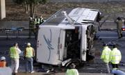 Rescue workers inspect the wreckage of a charter bus carrying the Bluffton University baseball team from Ohio after it plunged off a highway ramp in Atlanta and slammed into the pavement below. Six people on the bus were killed Friday, including the driver and his wife.