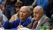 John Lungstrum, left, chief judge of the U.S. District Court of Kansas, sits courtside with Kansas University Athletics Director Lew Perkins during Saturday's men's basketball game against University of Texas.