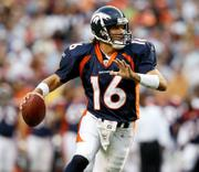 Denver quarterback Jake Plummer looks for a receiver during a 2006 game. The Broncos on Saturday traded Plummer to Tampa Bay.