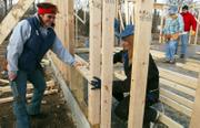 Janet Smalter, left, project coordinator, helps future homeowner Toni Husted frame a window Saturday morning during the Women Build Project at the Comfort Neighborhood in North Lawrence.