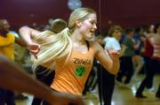Katy Parker leads a Zumba class at Lawrence Athletic Club, 3201 Mesa Way, swaying to a Latin beat as her students, reflected in a mirror, pick up the steps. Zumba is a music-based fitness craze that's gaining popularity in Lawrence and across the country.
