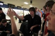 FREE STATE HIGH SENIOR KENNY ALTMAN high-fives teammates following a successful frame at the Kansas State High School Bowling Championship. Altman helped the Firebirds to a second-place team finish Saturday at Royal Crest Lanes.