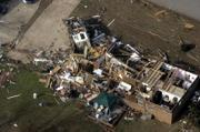 Enterprise High School was heavily damaged by a tornado Thursday in Enterprise, Ala. President Bush toured the tornado-damaged area Saturday. 20 people, including eight in the high school, were killed in Alabama, Georgia and Missouri in a huge storm system