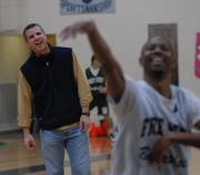 Free State basketball coach Chuck Law, left, jokes with one of his players. The Firebirds practiced Sunday at Free State in preparation for Wednesday's state opener in Emporia.