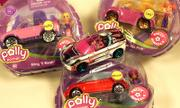 In a shift from its Matchbox racers geared toward boys, Mattel's Polly Wheels come with tiny removable Polly Pocket dolls and frosted plastic covering the metal chassis.