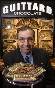 "Mel Cohen, the national sales manager of San Francisco-based Guittard Chocolate Company, displays samples of the company&squot;s products at a trade show in Chicago in May 2005. Like wine, fine chocolate carries a pedigree. Guittard was among the first U.S. companies to make ""single-origin"" chocolate, which had been available in Europe for many years. This year, another chocolate company, Hershey&squot;s, began selling single-origin chocolates in stores such as Target and Wal-Mart."