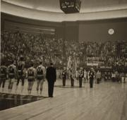 Kansas University players, from left, Maurice King, Gene Elstun, Wilt Chamberlain, John Parker and Ron Loneski stand at attention during the playing of the National Anthem prior to the NCAA National Championship game. The game was played in Municipal Auditorium in Kansas City, Mo., on March 23, 1957.