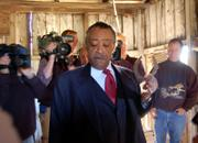 The Rev. Al Sharpton holds a horseshoe in a building that once housed some of his relatives on the grounds of an old plantation home in Edgefield County, S.C. Phillip White, at right, who now owns the home, on Monday gave Sharpton a horseshoe he found in the slave quarters on his property.