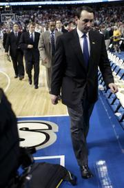 Duke coach Mike Krzyzewski walks off the court after a 85-80 loss to North Carolina State. The Blue Devils fell in the first round of the ACC tournament on Thursday in Tampa, Fla.