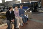 Kansas University student Katey Birge, of Denver, was ecstatic about a recent vote in KU Student Senate that will enable the purchase of Americans with Disabilities Act-compliant buses to go into service next fall. Birge, center, who is president of the AbleHawks student group, and AbleHawks members Derek Zarda, Shawnee senior, left, and Zach Coble, Winfield senior, worked together to get the accessible buses.