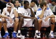 From left, UCLA's Lorenzo Mata, Alfred Aboya and James Keefe dejectedly watch the final moments of UCLA's 76-69 loss to California. UCLA tumbled in the second round of the Pac-10 tournament Thursday in Los Angeles.