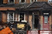 Charred wreckage sits piled at the scene of a blaze that claimed the lives of nine people, including eight children, in a four-story apartment building Thursday in the Bronx borough of New York. An extended family was trapped inside the house and could be heard screaming for help in the night, witnesses and authorities said.